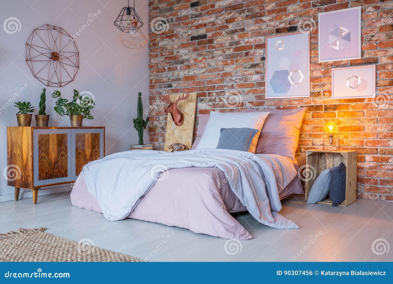 Design industriale della camera da letto fotografia stock for Design della camera degli ospiti