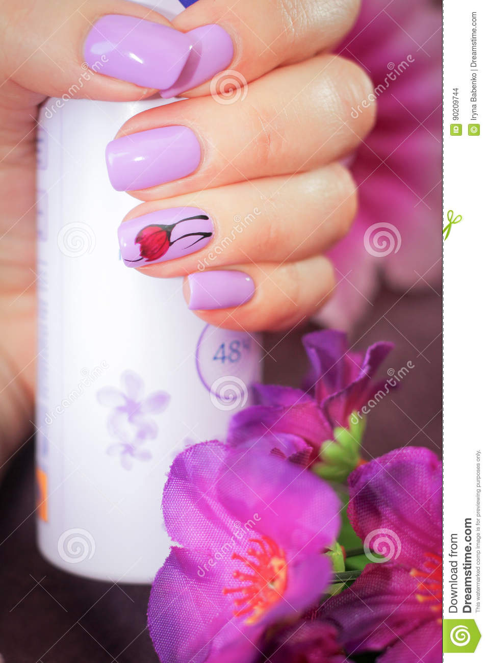 The Design Of Nails Spring Style In Hand A Can Of Deodorant Stock