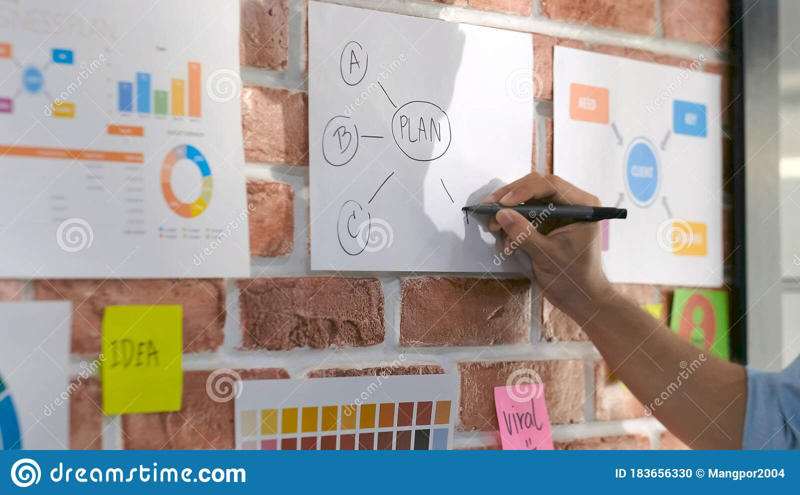 Design And Think Close Up Of Creative Design Man Hand Writting Plan On Paper Work Ideas At Office Wall With Concentration Asia Stock Photo Image Of Note Focus 183656330