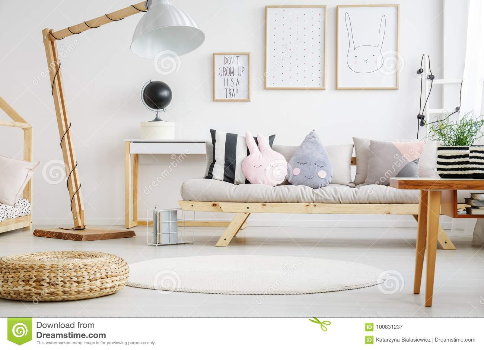 Designed Lamp Near Beige Sofa