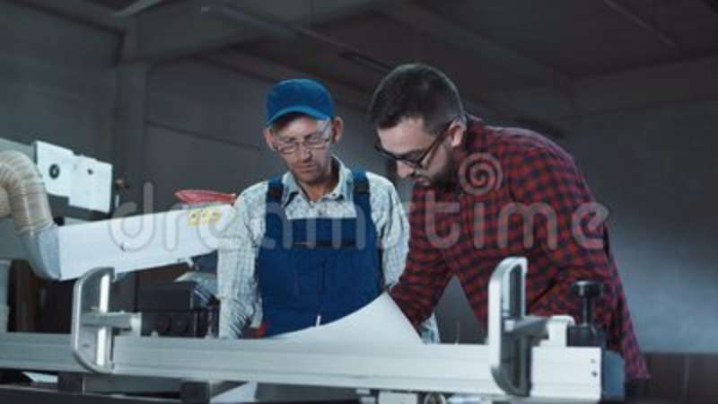 Designer And Carpenter Discussing Drawings Stock Footage Video Of
