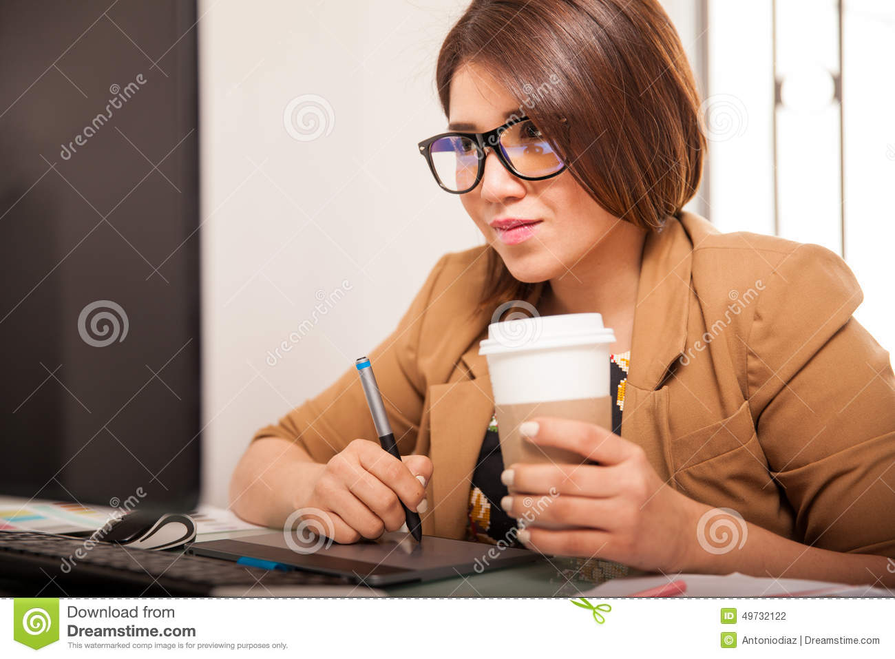 Coffee At Work ~ Graphic designer drinking cup of coffee stock image