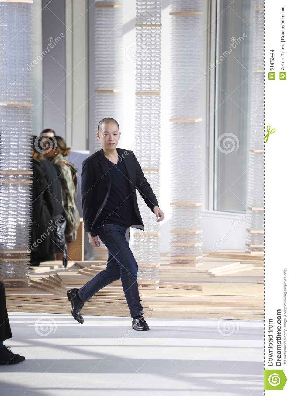 Designer jason wu walks the runway at the boss womens for Jason wu fashion designer