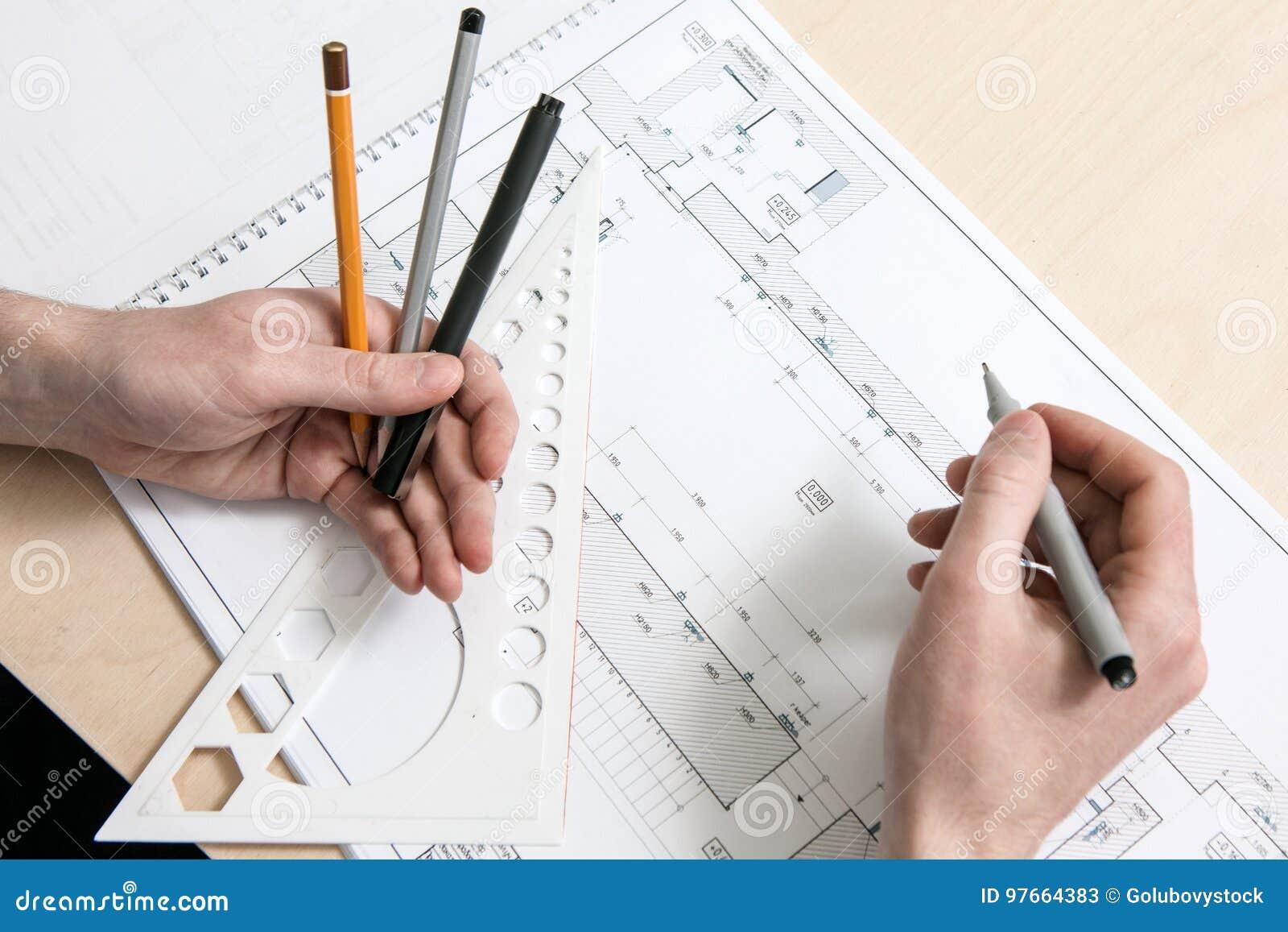 Designer`s hands working on scheme