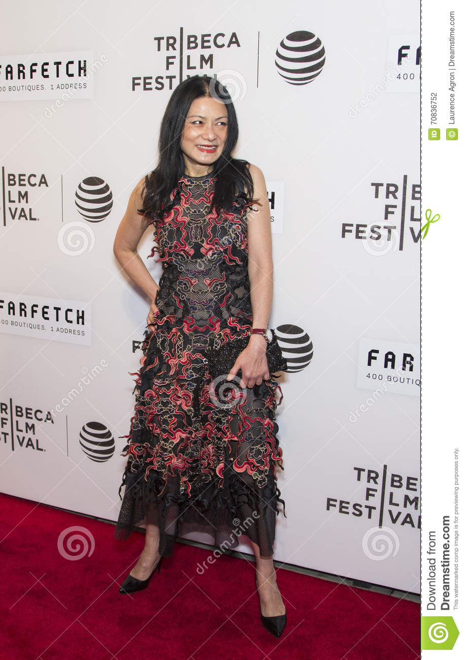 ee94f99c6d5 Fashion designer Vivienne Tam arrives on the red carpet for Opening Night  at the 2016 Tribeca Film Festival