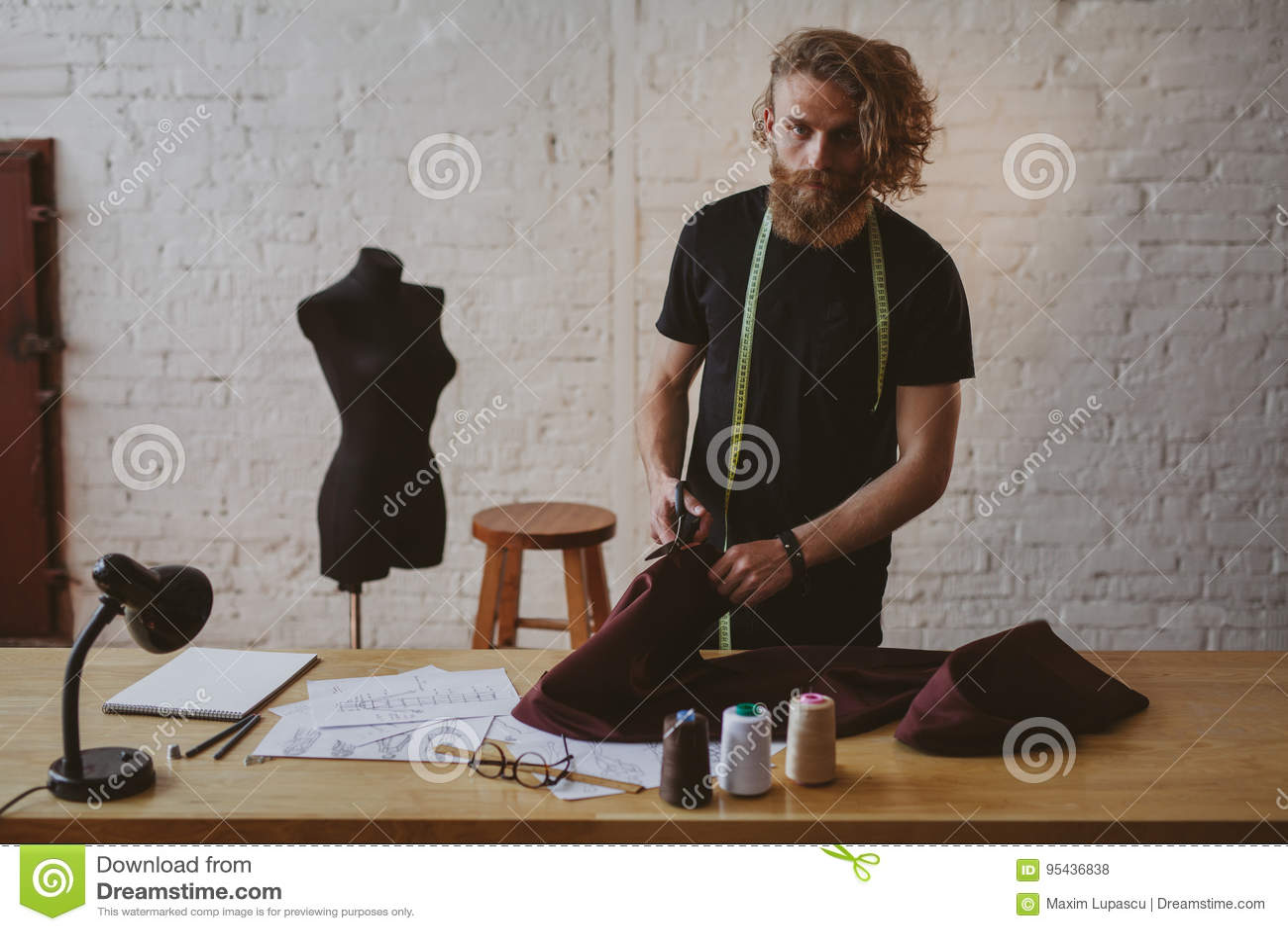 Designer working on new clothe in studio