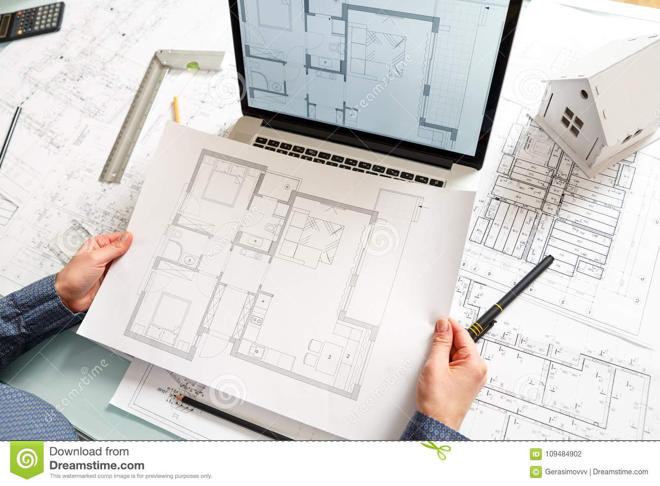 Designer works on a blueprint of new apartments stock photo image download comp malvernweather Gallery