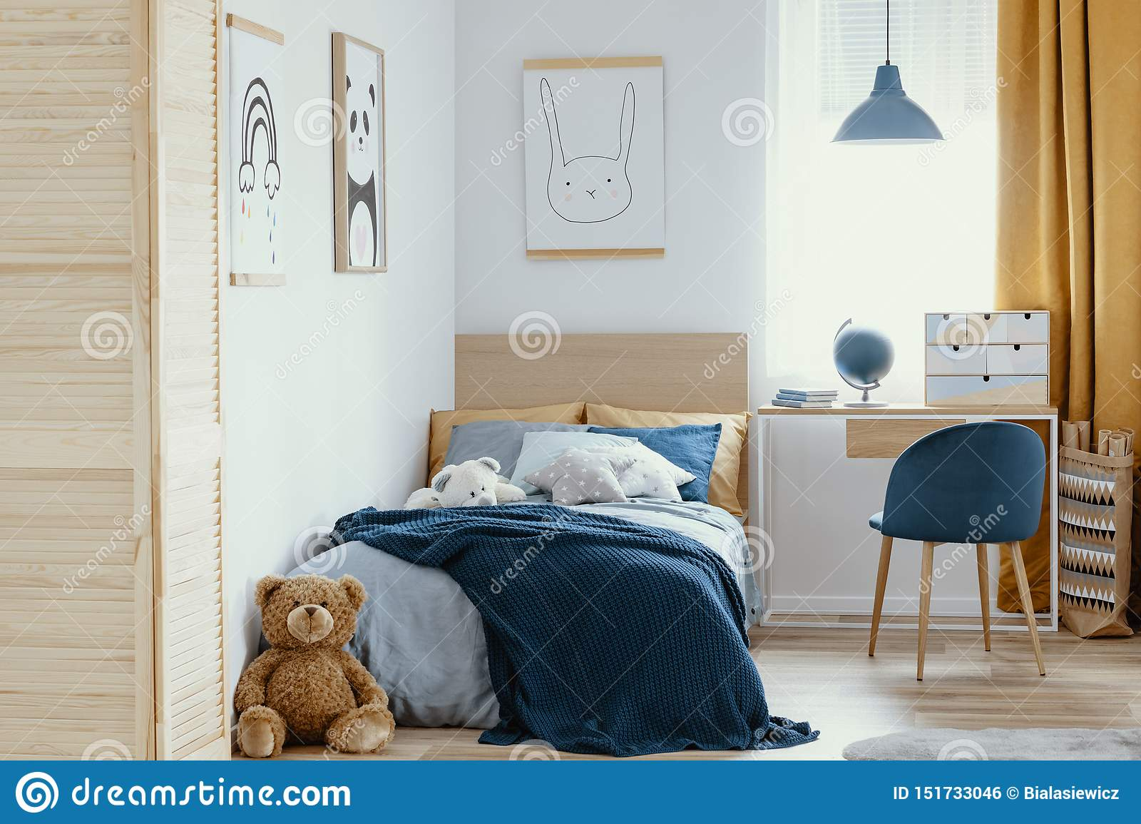 Image of: Desk Chair And Single Bed With Blue Bedding In Cozy Bedroom Interior For Children Stock Photo Image Of Decor Children 151733046