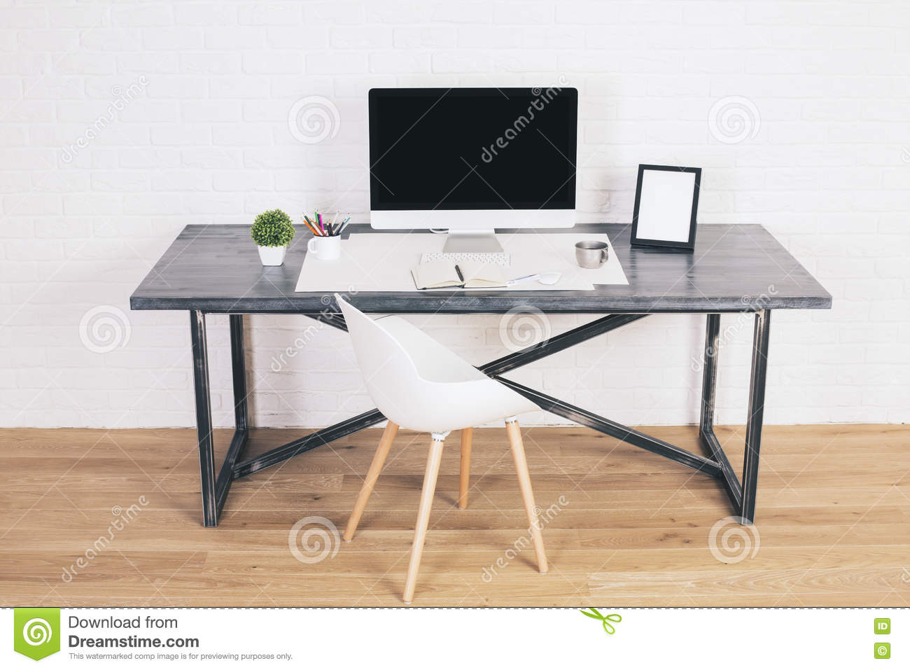 desk with frames and monitor stock photo image