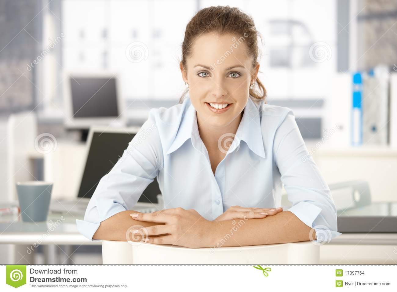 Desk office sitting smiling woman young