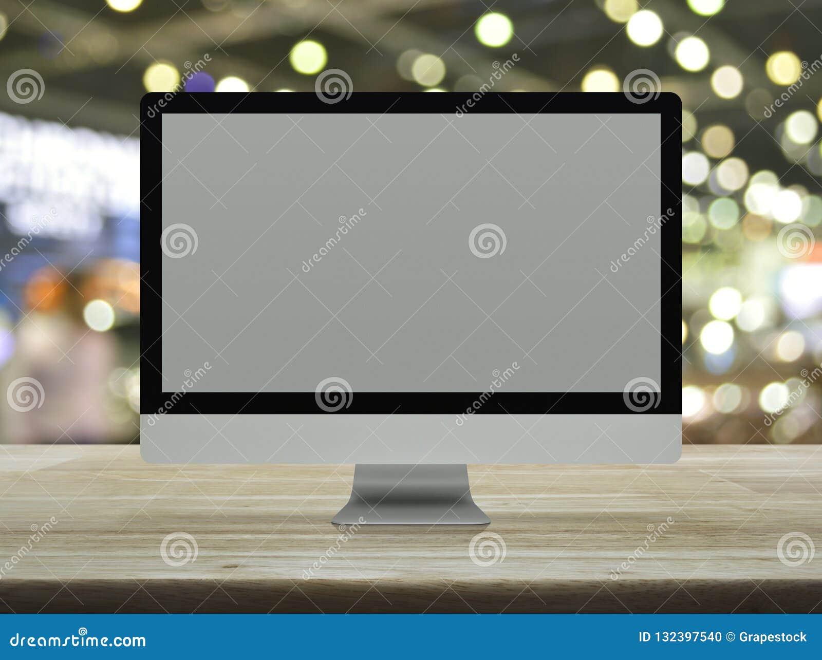 Desktop σύγχρονο όργανο ελέγχου υπολογιστών με την γκρίζα ευρεία οθόνη σε ξύλινο