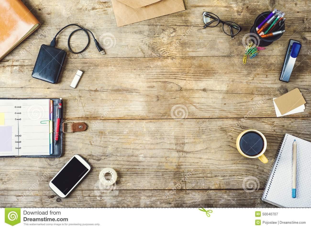 Desktop Mix On A Wooden Office Table. Stock Photo - Image: 50040707