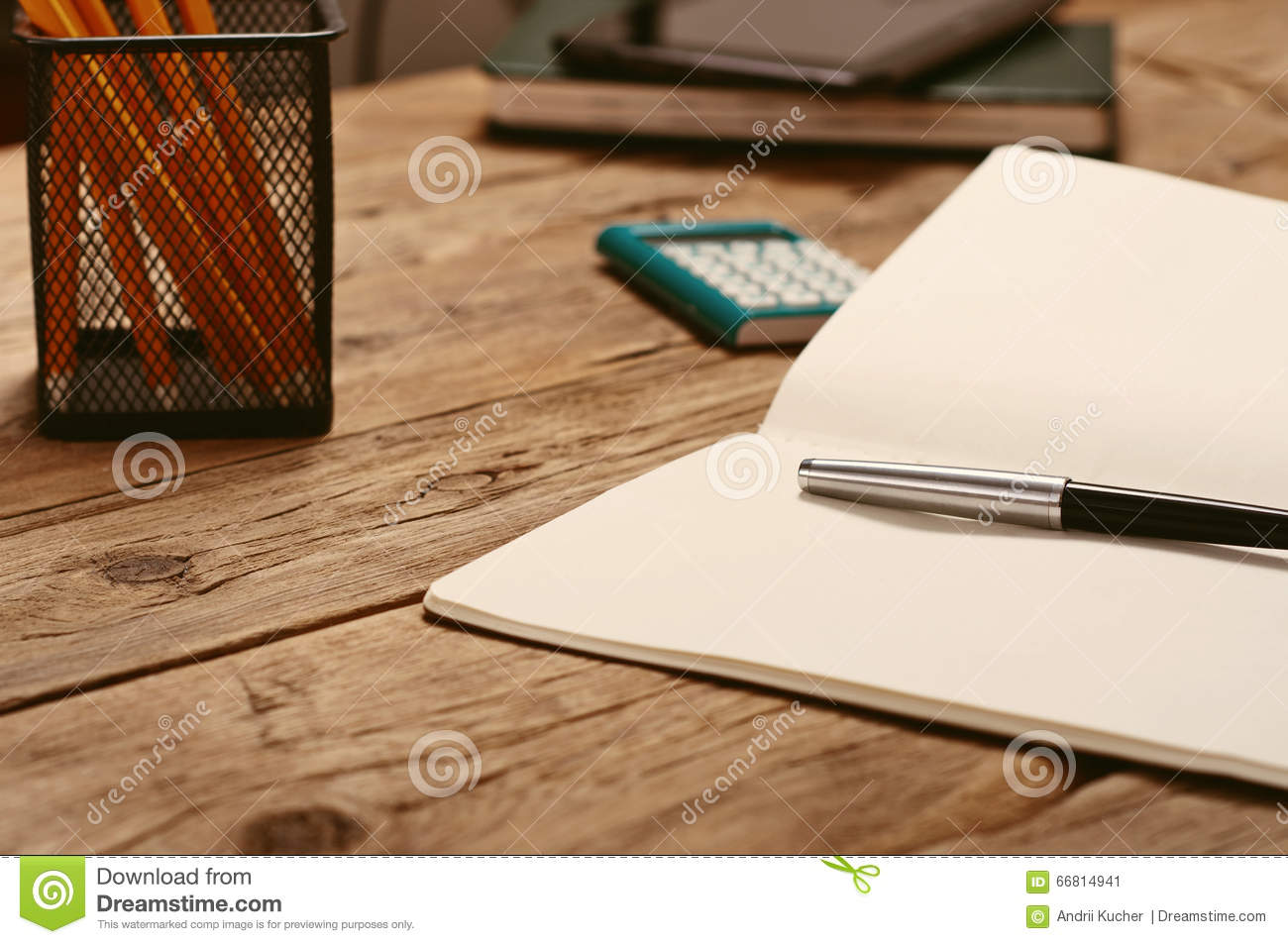 On the desktop, open notepad with pen and calculator