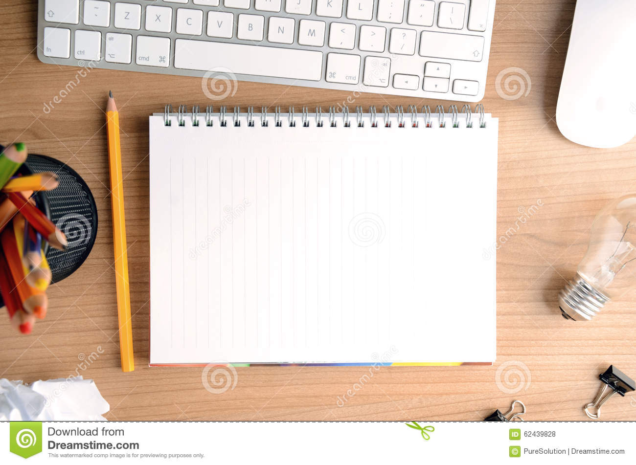 desktop with paper stationery computer blank notepad and light
