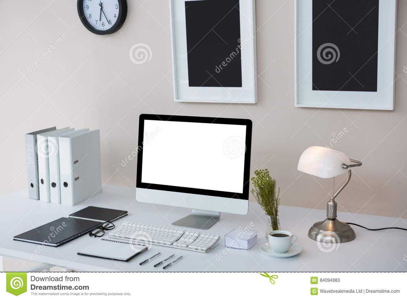 Desktop Pc On Desk With Picture Frames On Wall Stock Image Image