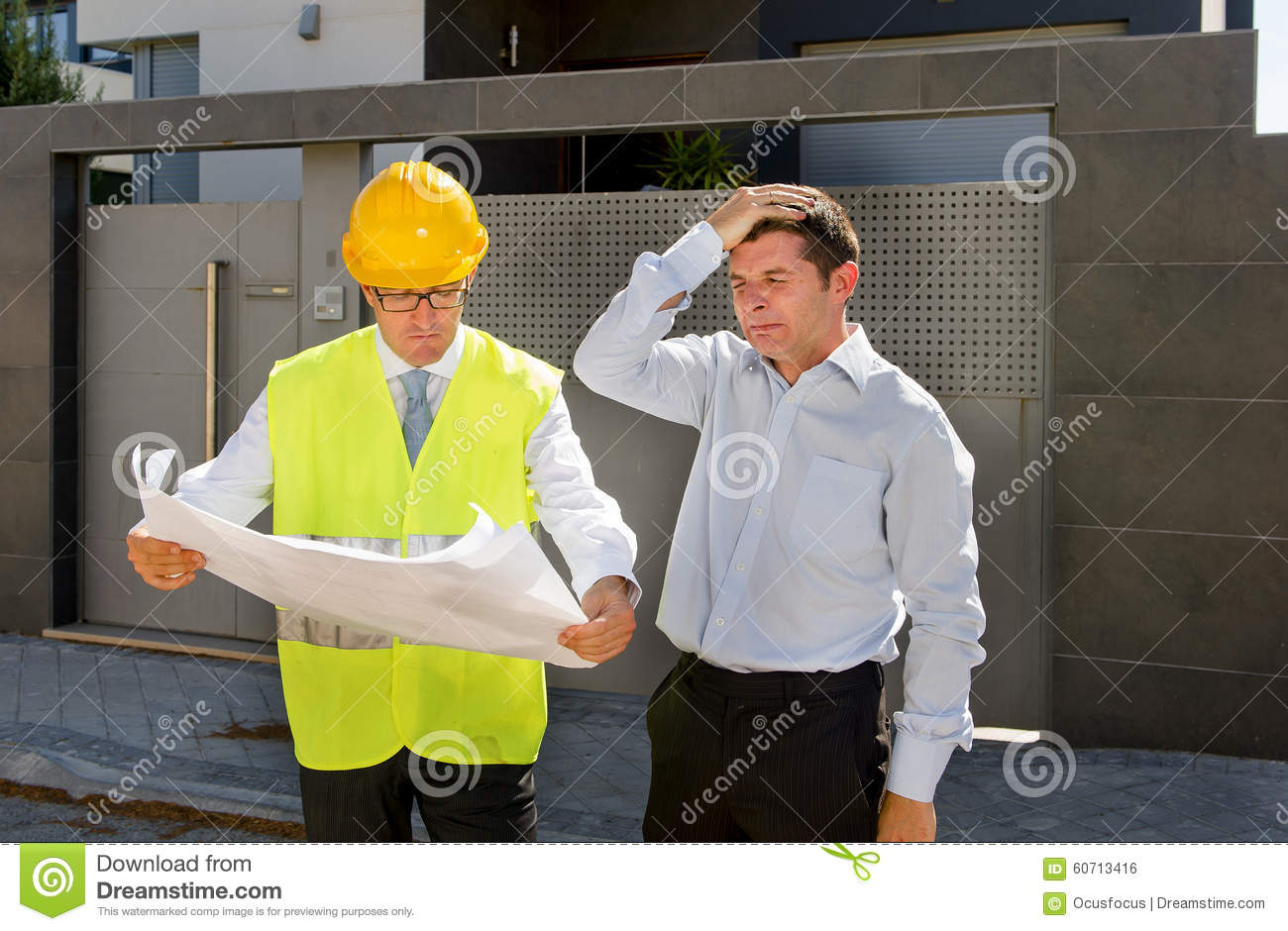 desperate customer in stress and constructor foreman worker desperate customer in stress and constructor foreman worker helmet and vest arguing outdoors on new