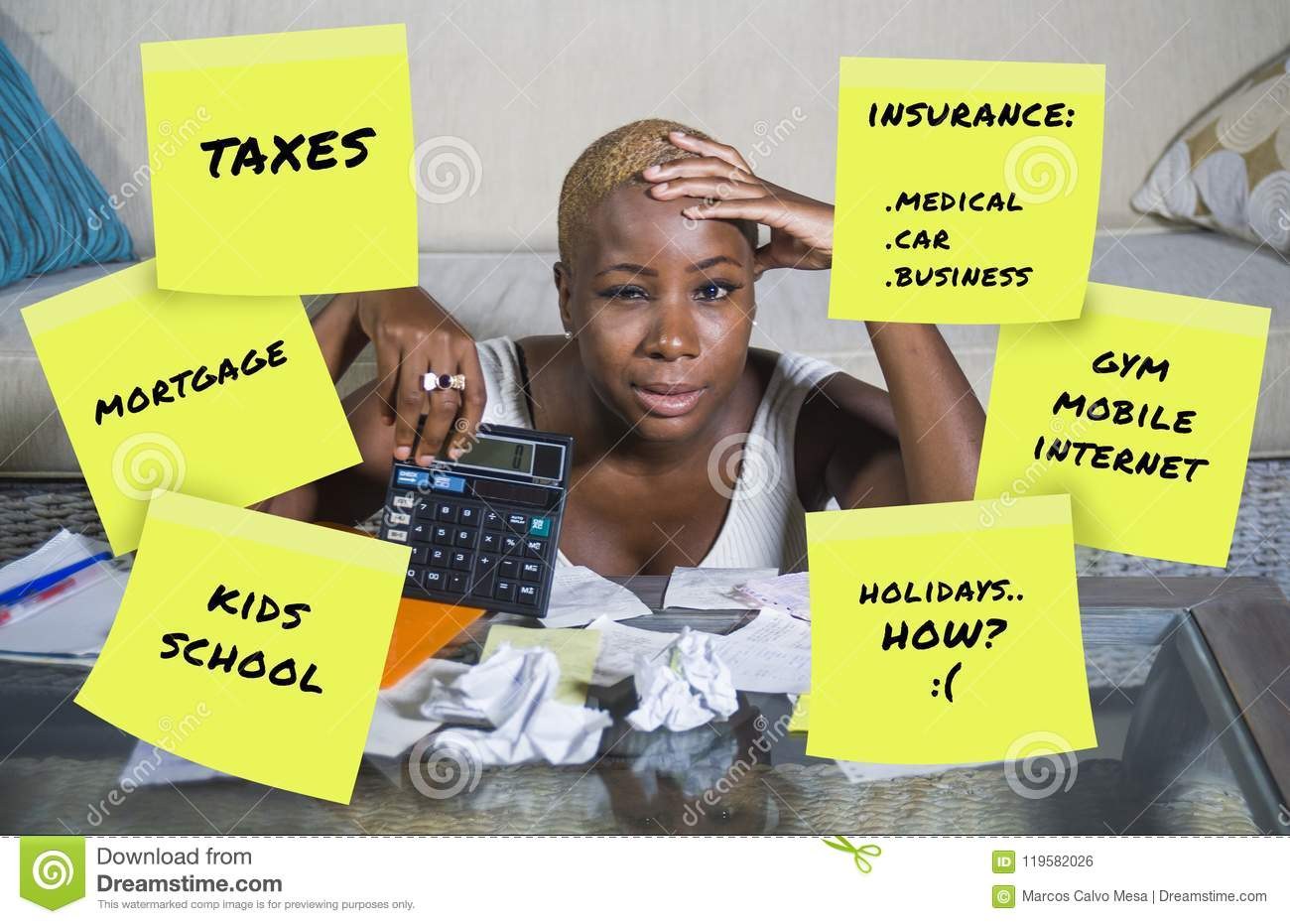 Desperate and frustrated black afro american woman domestic accounting worried about money paying taxes calculating expenses and p