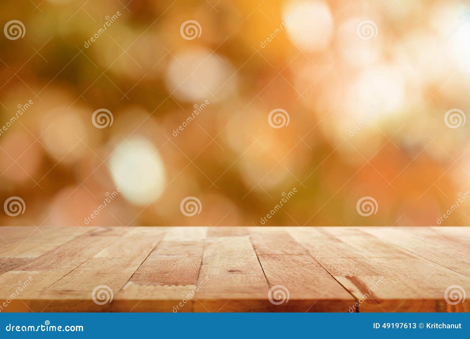 Dessus de table en bois sur le fond brun d abrégé sur bokeh