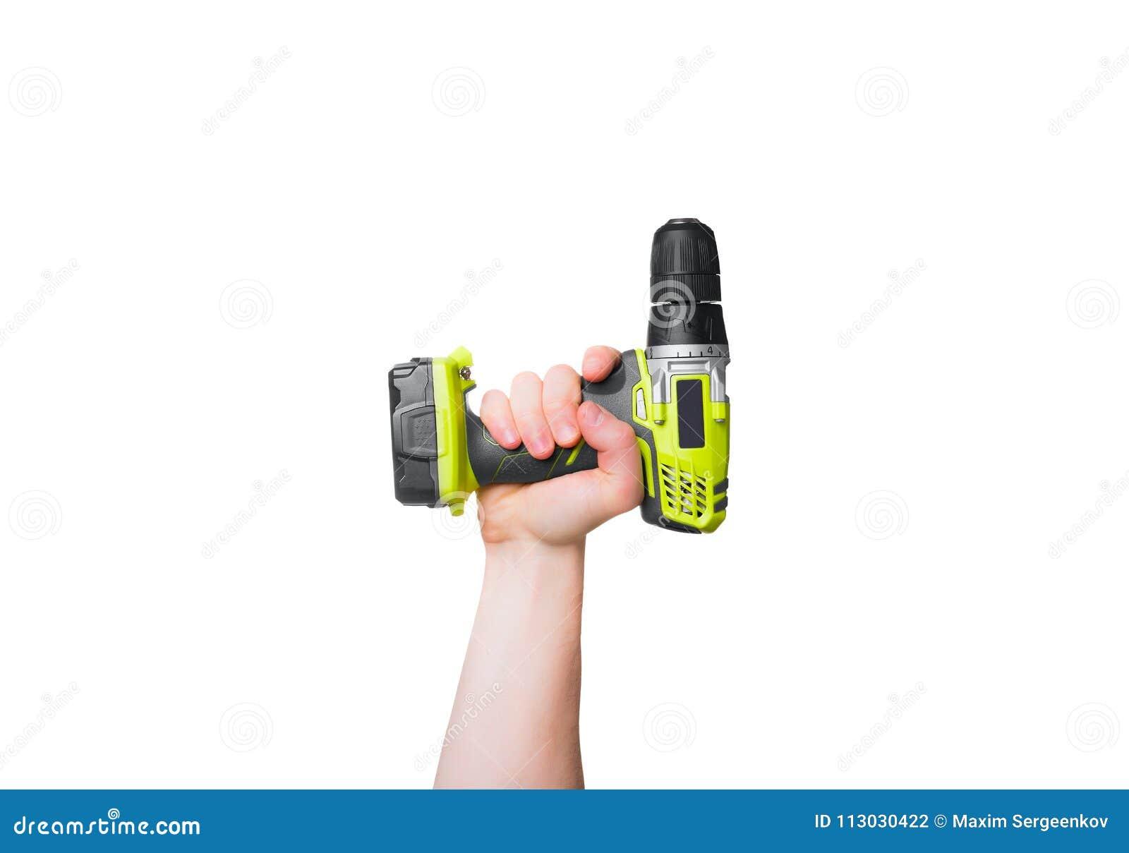 Destornillador amarillo en la mano masculina