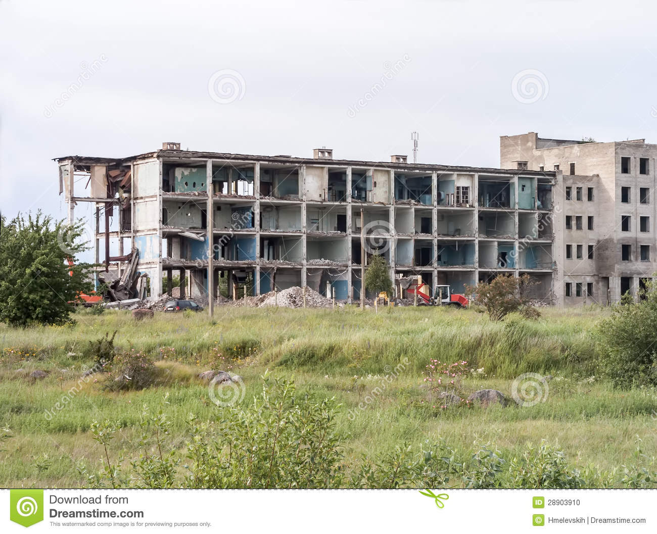Pile Of Building Debris : Destroyed building with pile of debris stock photo image