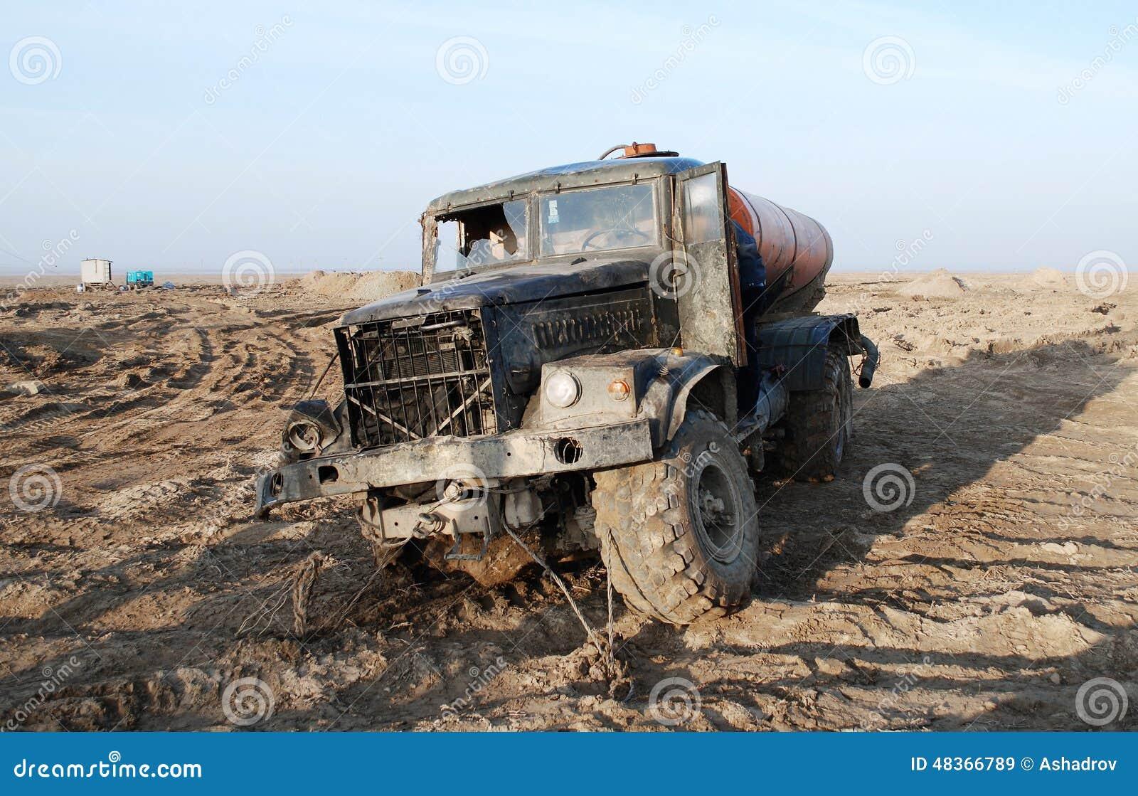 destroyed-military-truck-desert-old-army-abandoned-48366789.jpg