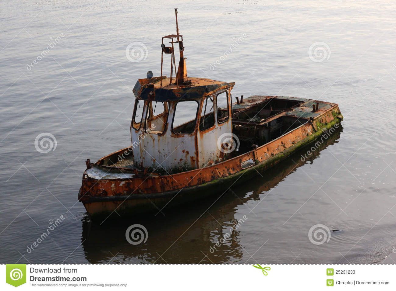 Destroyed rusty old boat in the water stock photos for What to do with an old boat