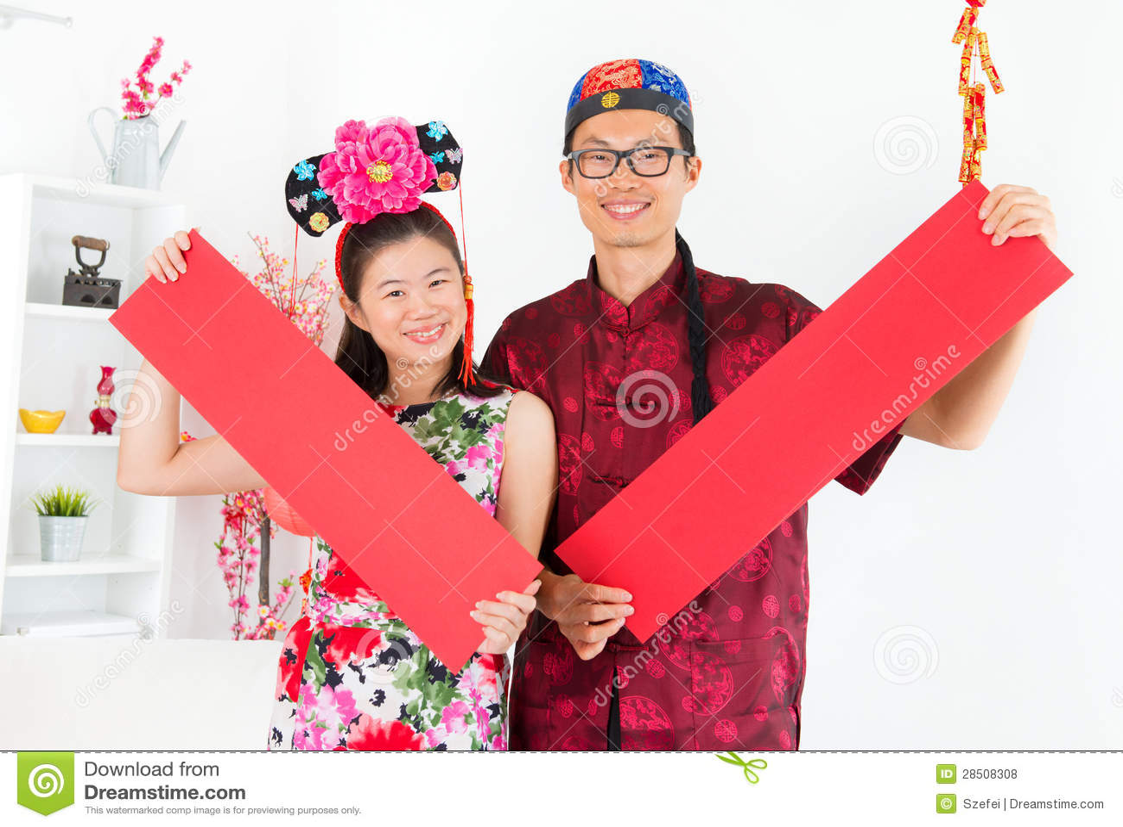 Det asiatiska folket röd visning fjädrar couplets