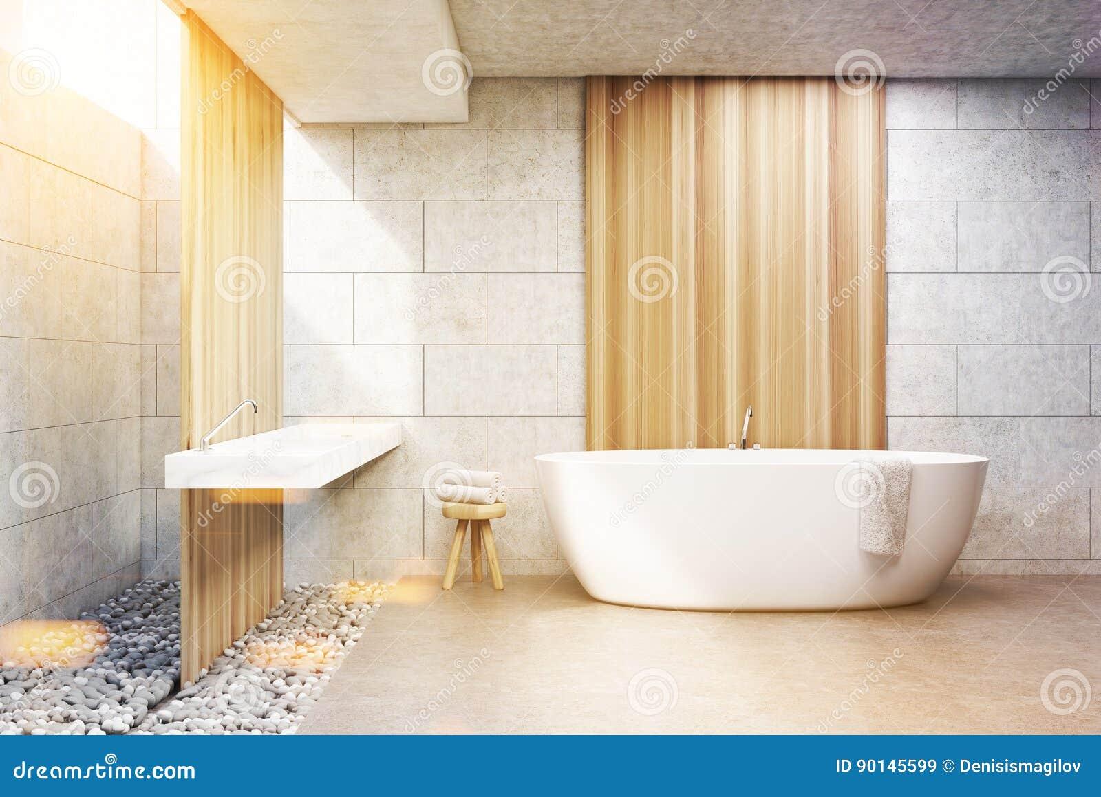 Det gråa tegelstenbadrummet, vit badar, beklär, tonat