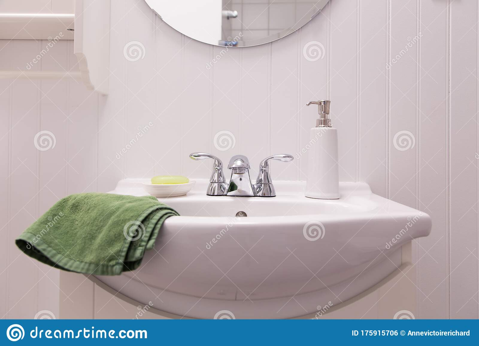 detail of all white bathroom with sink porcelain soap dispenser and green bar of soap in dish stock photo image of germs copy 175915706