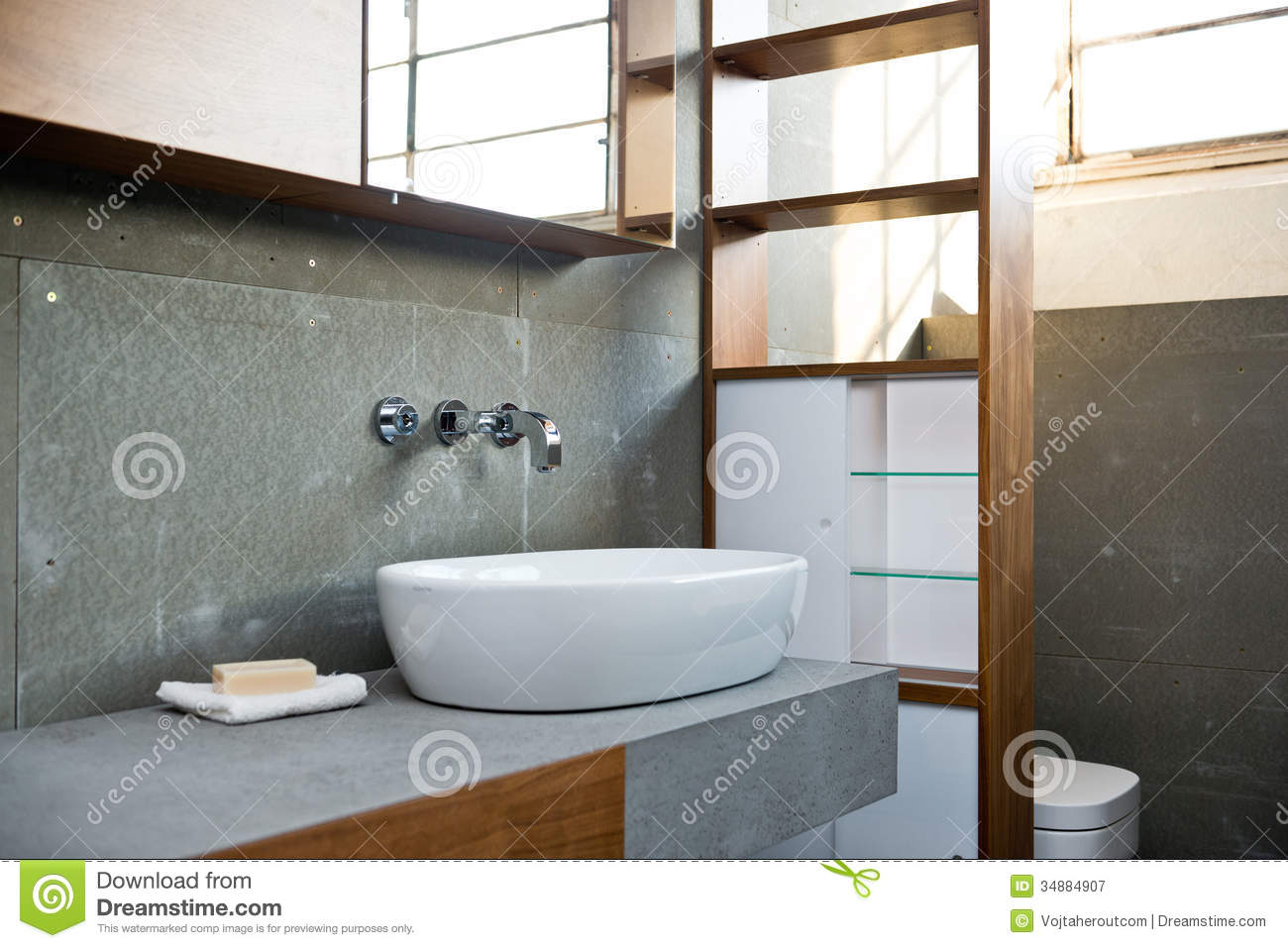 white bathroom interior with concrete walls and tiled floor stock