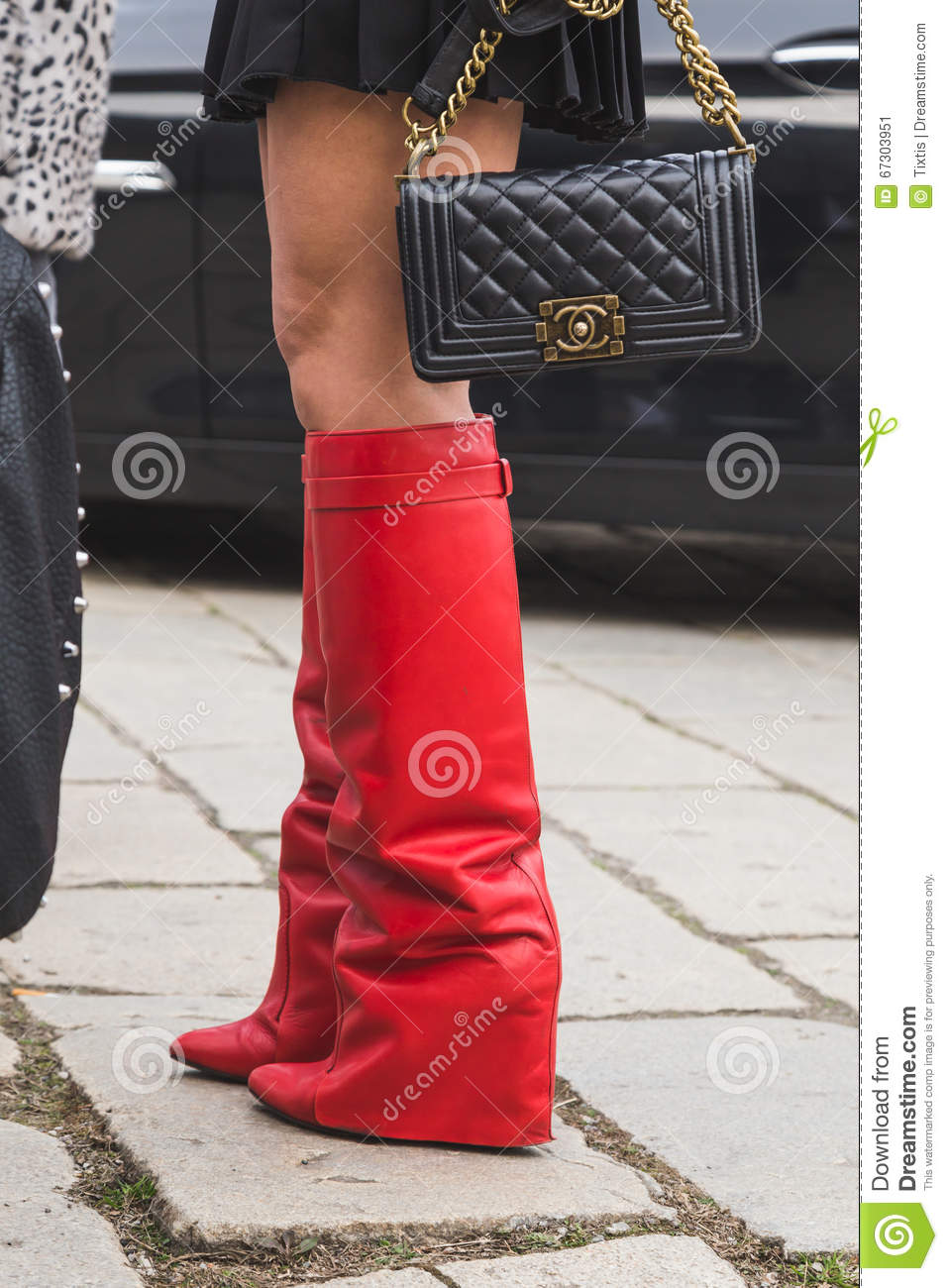43fe5886 MILAN, ITALY - FEBRUARY 24: Detail of boots outside Gucci fashion show  building for Milan Women's Fashion Week on FEBRUARY 24, 2016 in Milan.