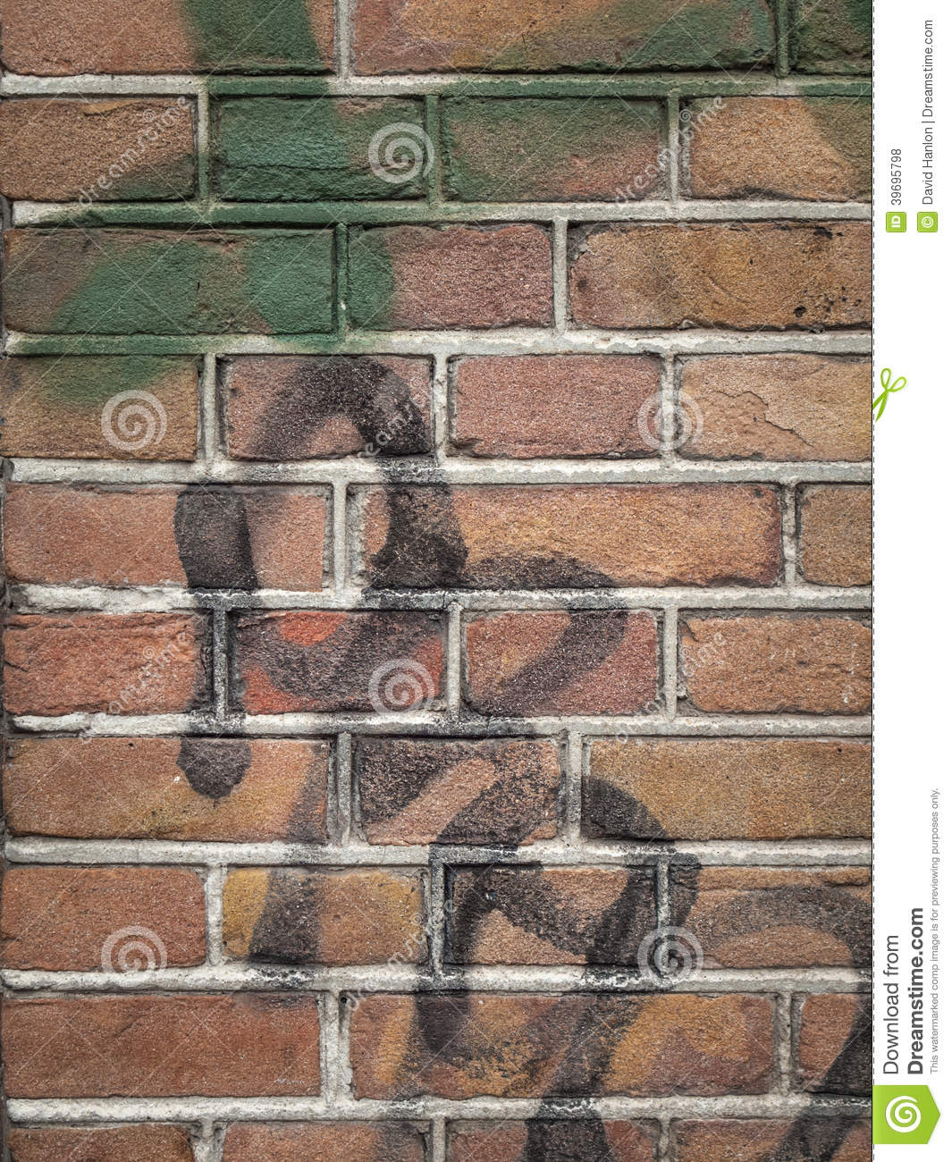 detail of red brick wall wth grey mortar and spray paint graffiti in. Black Bedroom Furniture Sets. Home Design Ideas
