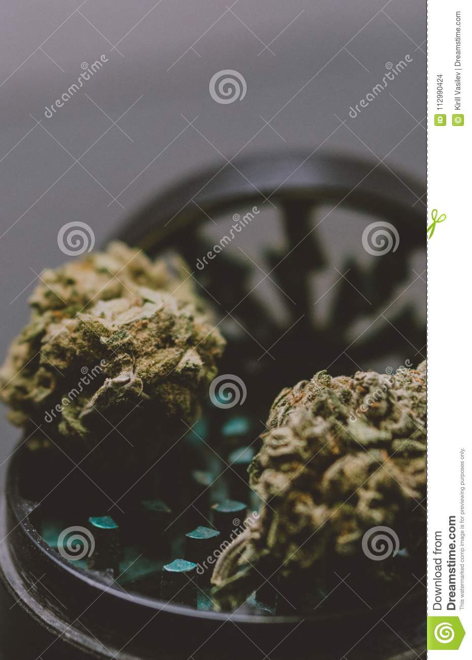 Detail of cannabis buds KUSH on glass background - medical marijuana dispensary concept. Social insta size for stories