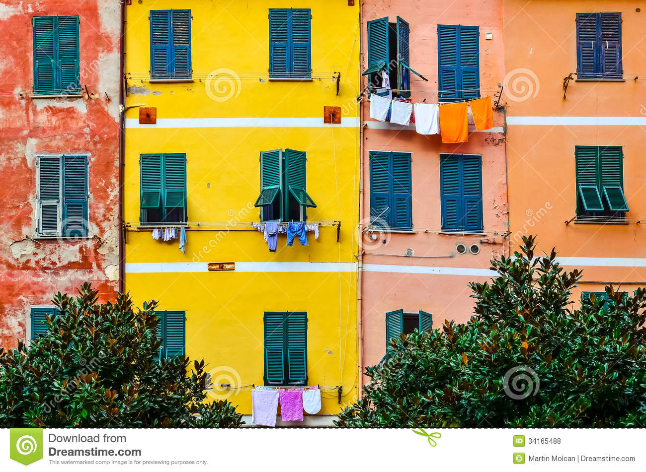 Colorful House detail of colorful house walls, windows and drying clothes royalty