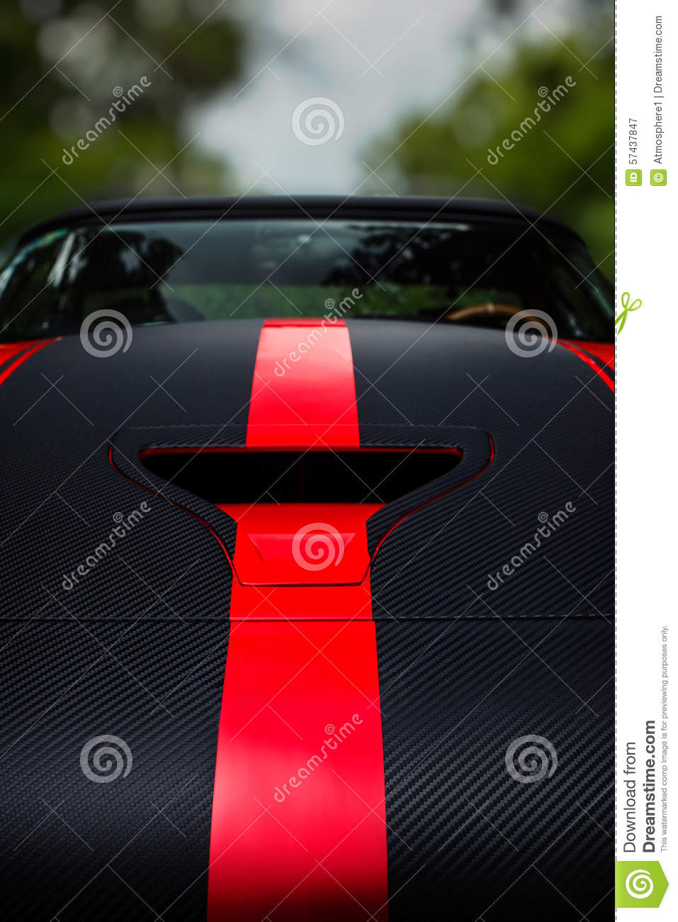 Detail of a dark racing sport car with bonnet scoop vent and red stripes