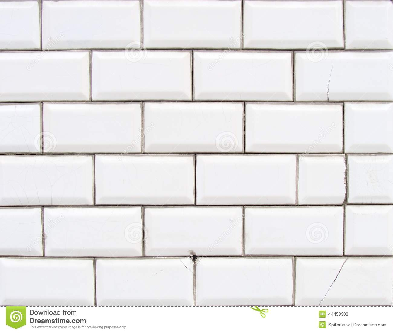 Detail Of A Glossy White Beveled Tile Wall With Damage