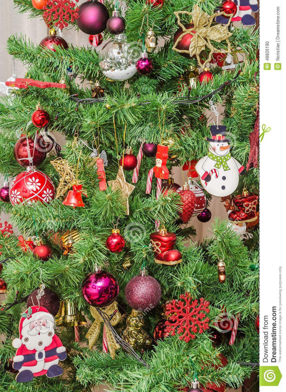 Detail Of Green Christmas Tree With Colored Ornaments, Globes, Stars ...