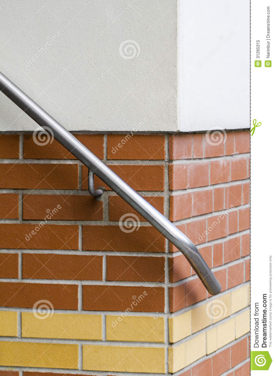 detail of an hand rail on a brick-wall royalty free stock photo