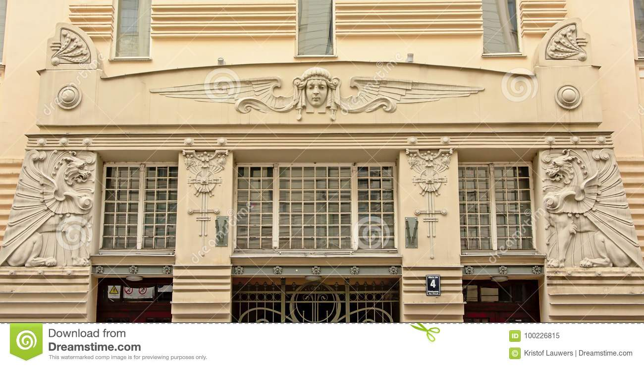 Art deco style decorated windows with winged head and dragons