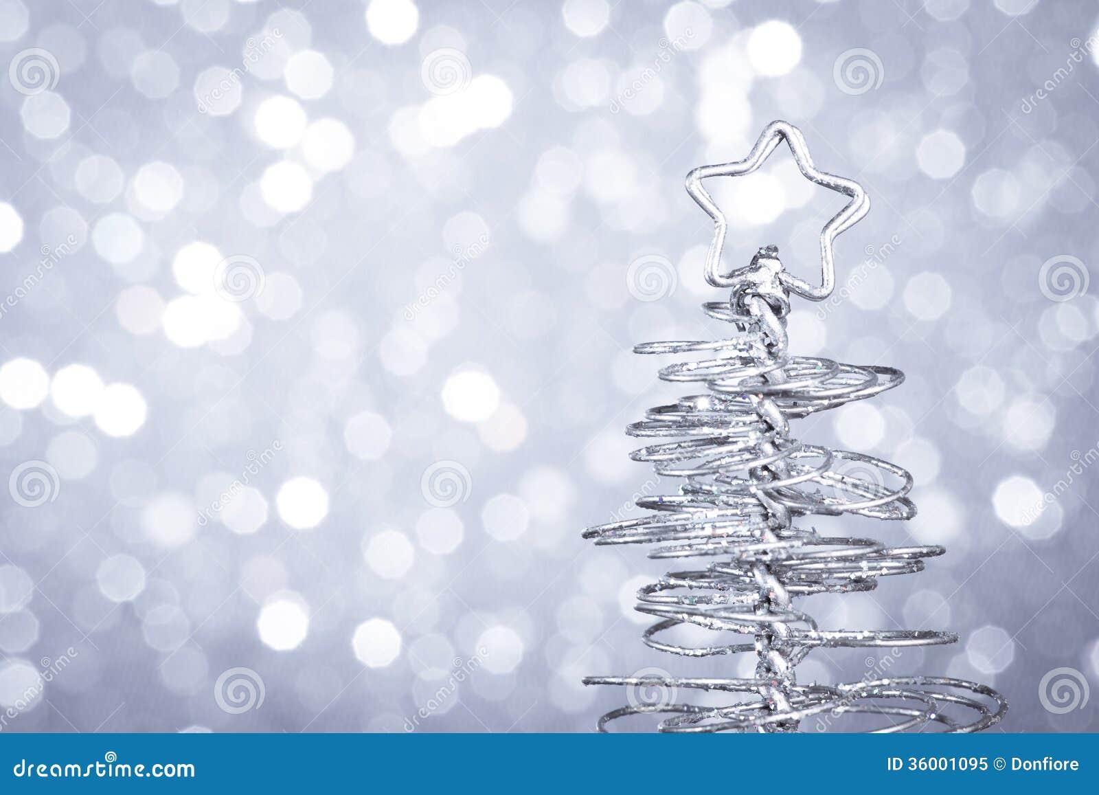 Detail of metallic modern christmas tree on wood table Modern christmas