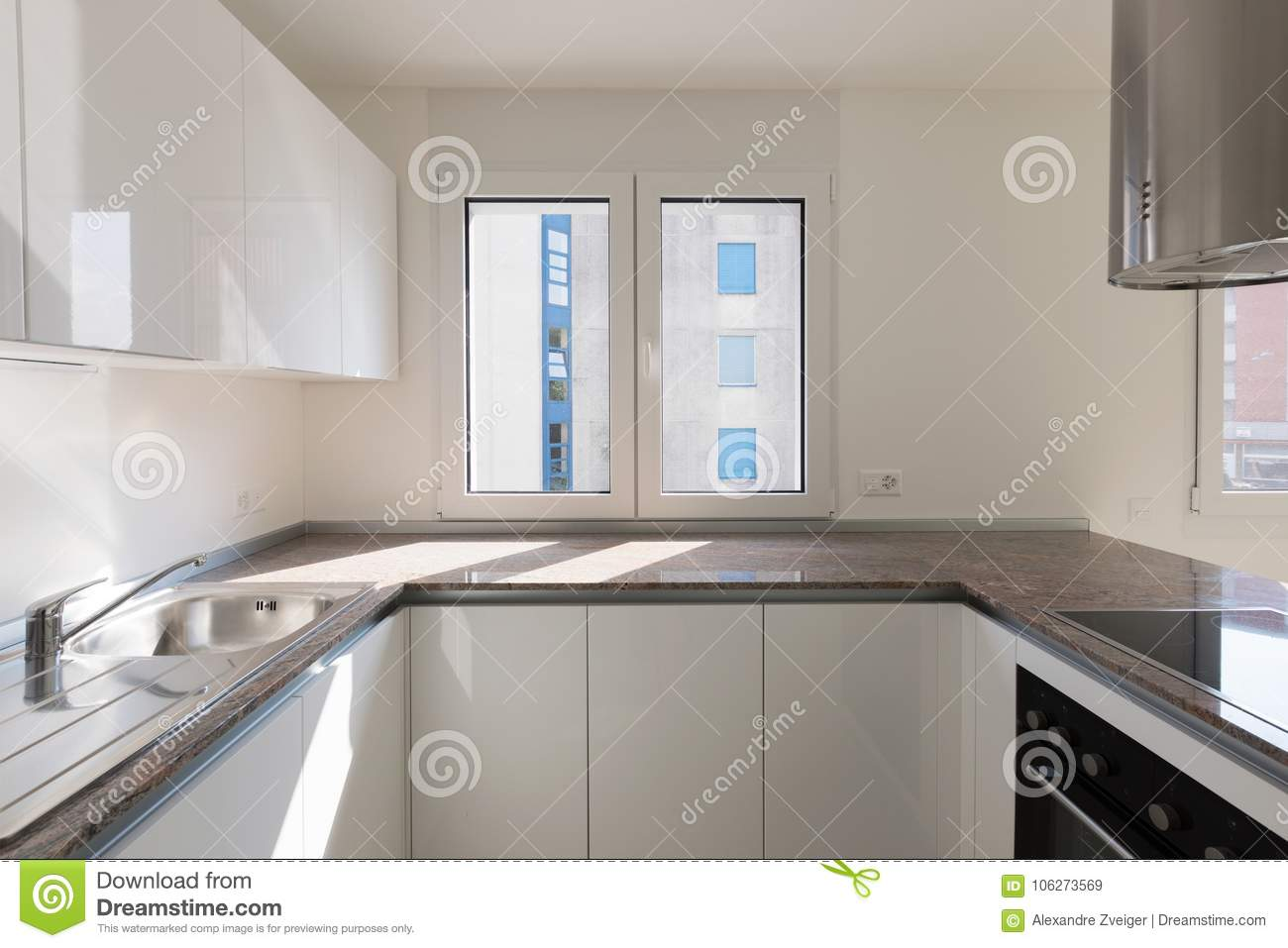 Detail Of Modern Kitchen With Marble Floor Above The Sink A Window That Lets In Lots Natural Light