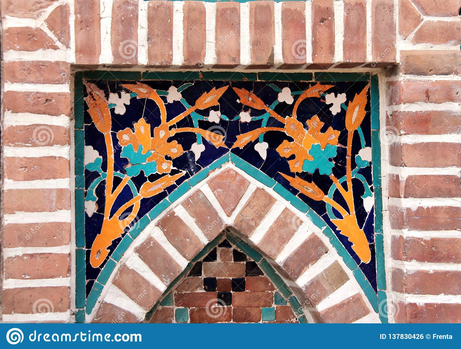 Detail of old mosaic wall with traditional georgian floral pattern