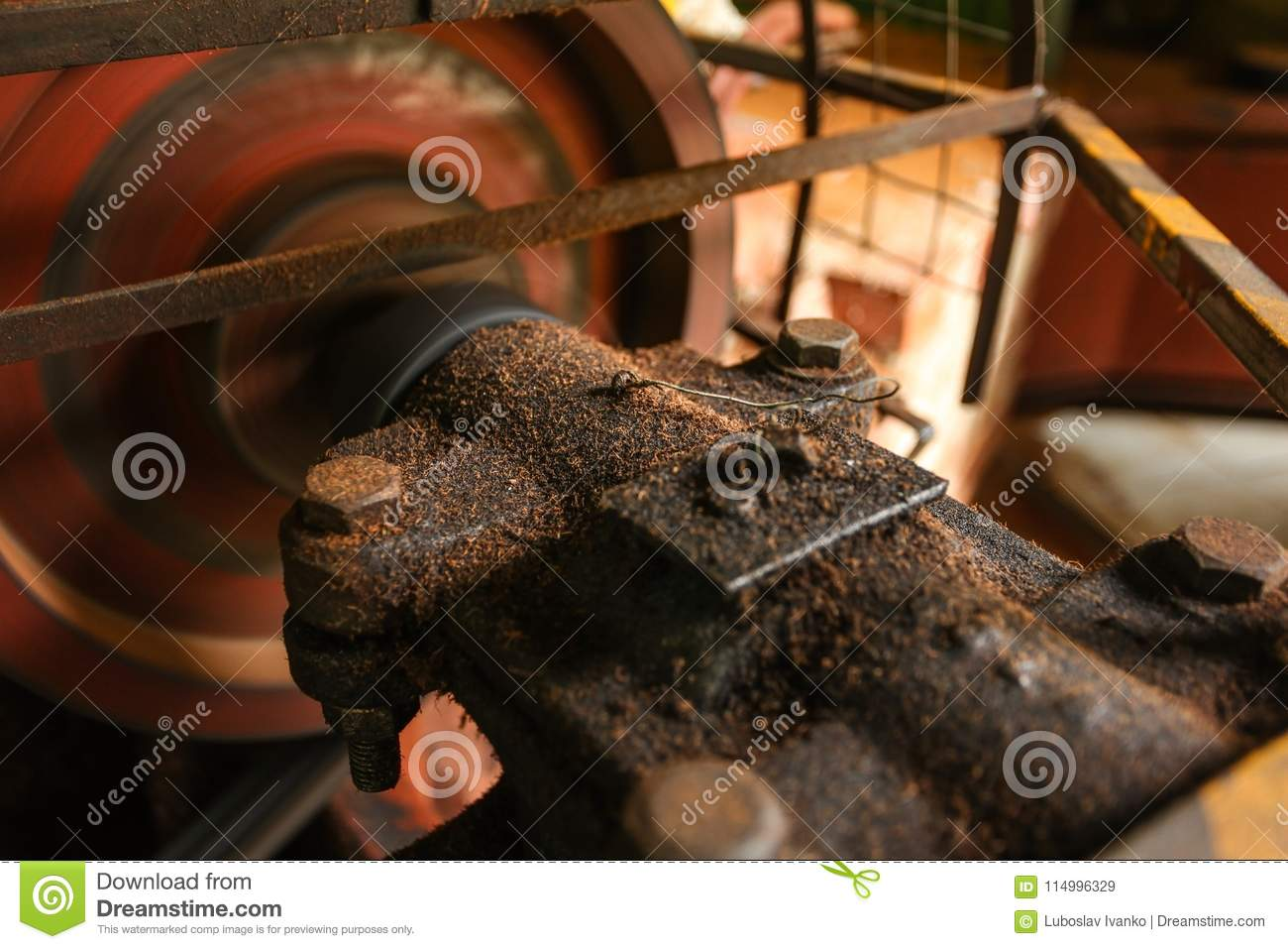 Detail on old rusty motor mechanism, rotor moving, metal axis co