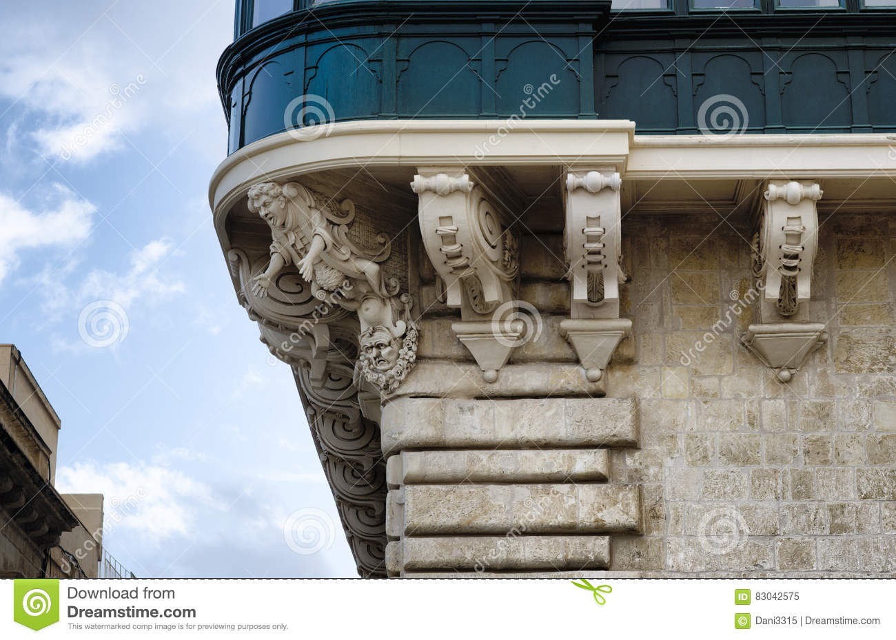 Detail of an old urban building stone facade with decorative elements