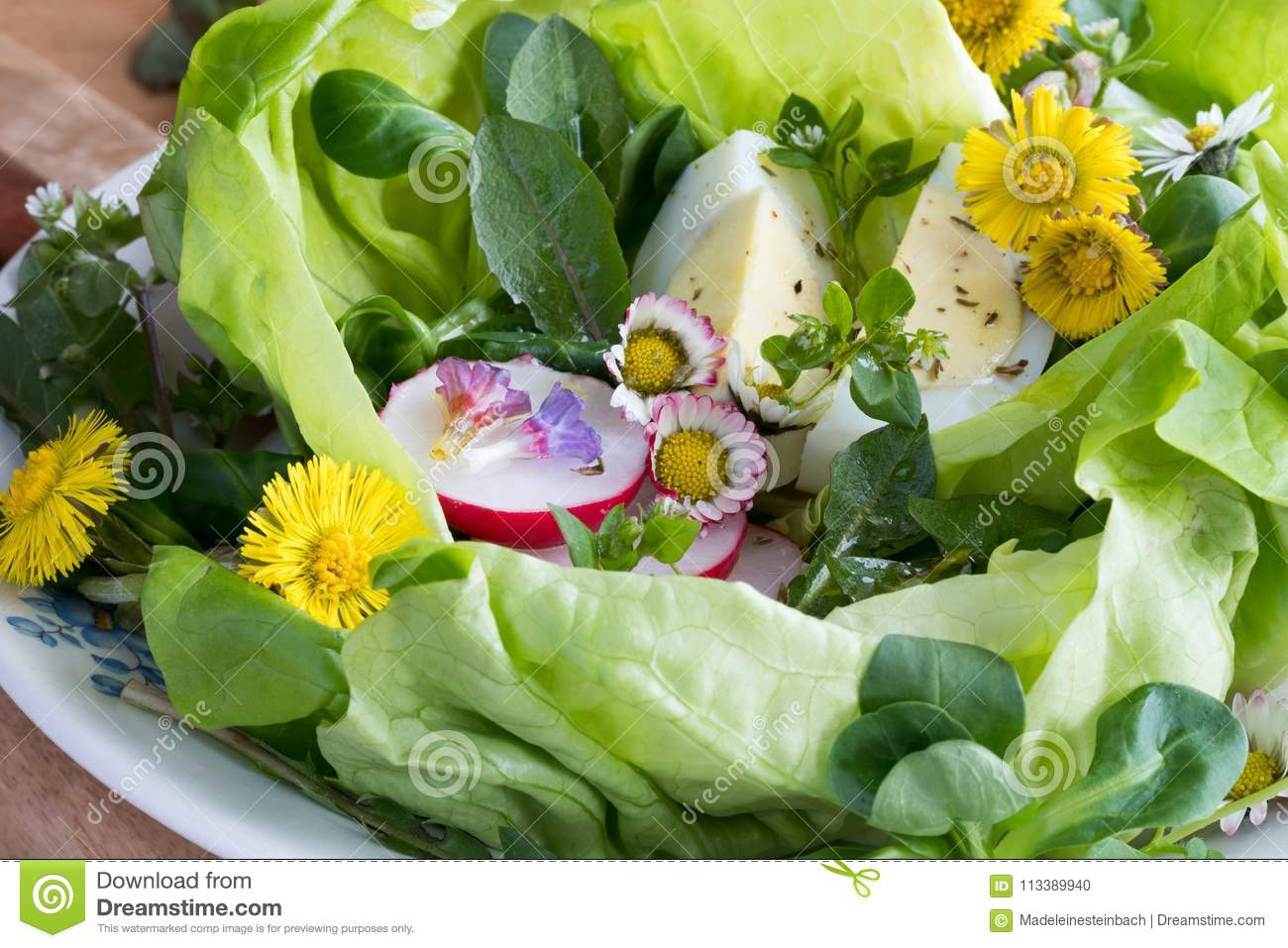 Detail of a spring salad with eggs and wild edible plants