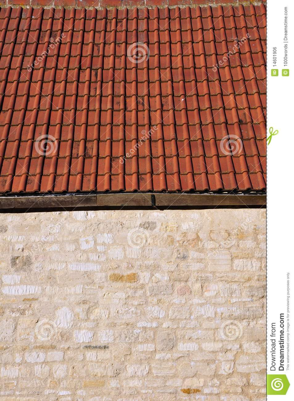Detail Of A Stone Wall And Roof Tiles Royalty Free Stock
