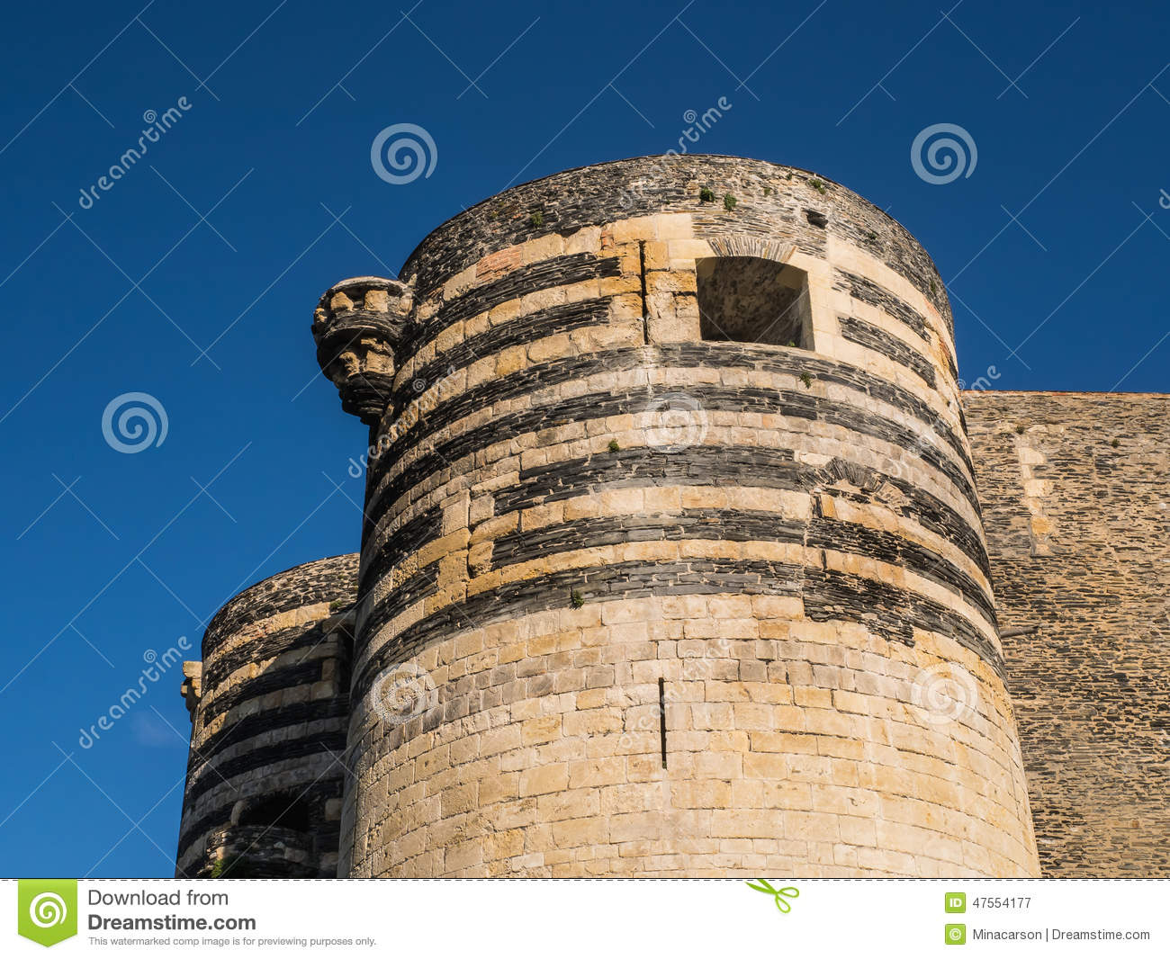 Detail of tower at Angers chateau, France, on a summer day