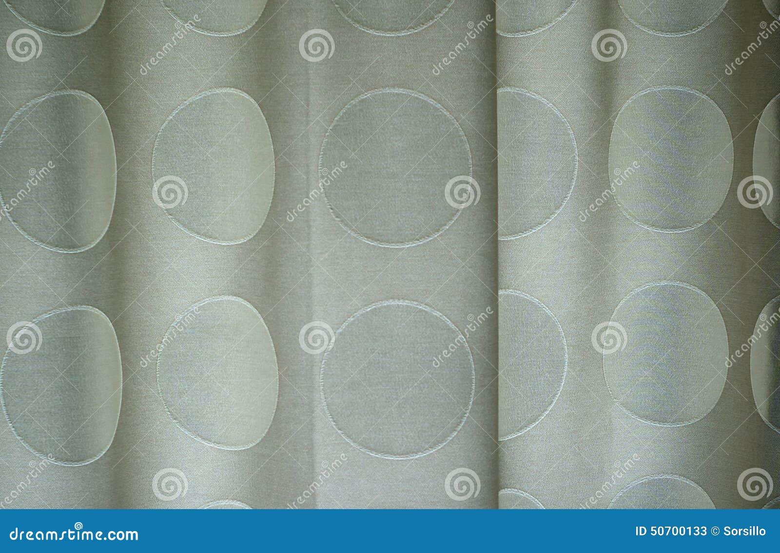 Detail van polka gestippelde gordijnen