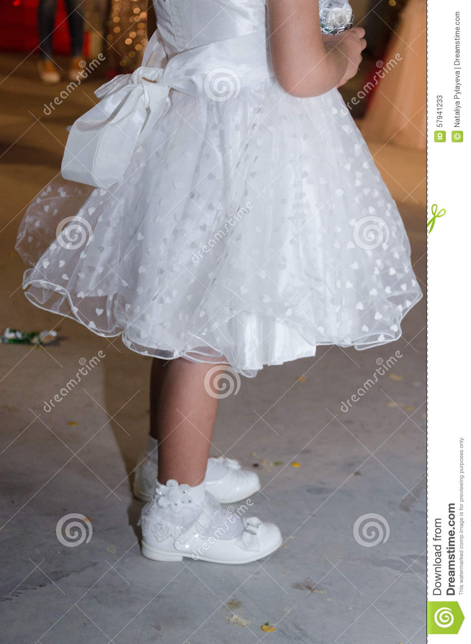 Detail Of A White Dress Girl With A Bow And White Hearts,white Socks ...