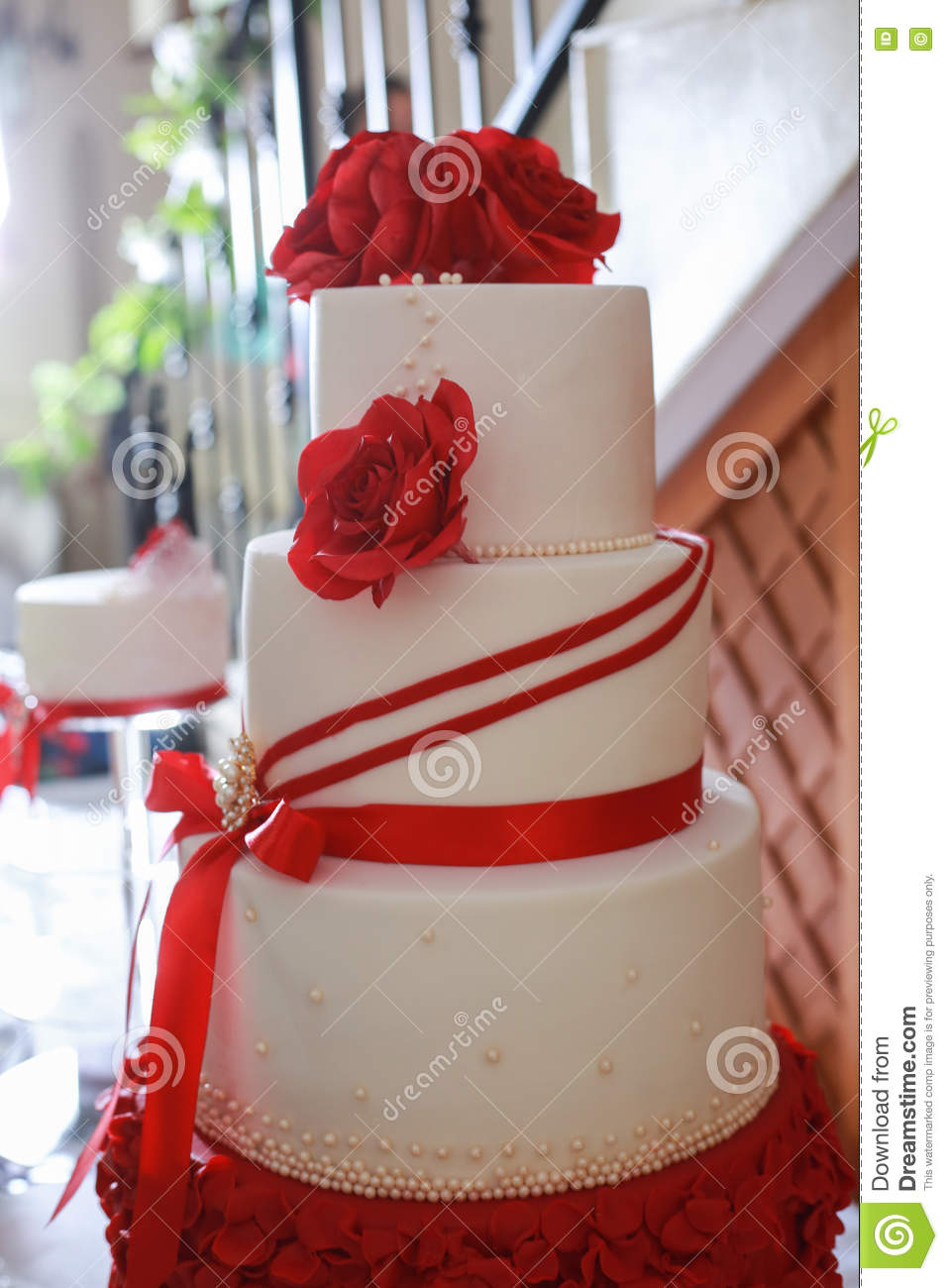 Detail of white layered wedding cake with red edible flowers stock detail of white layered wedding cake with red edible flowers mightylinksfo